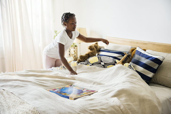 teaching kids responsibility making a bed