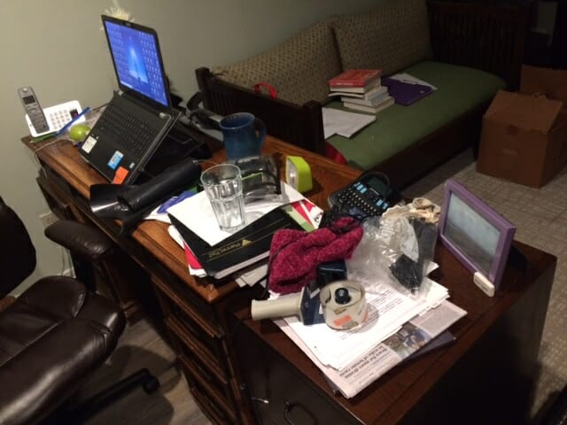 cluttered and disorganized desk