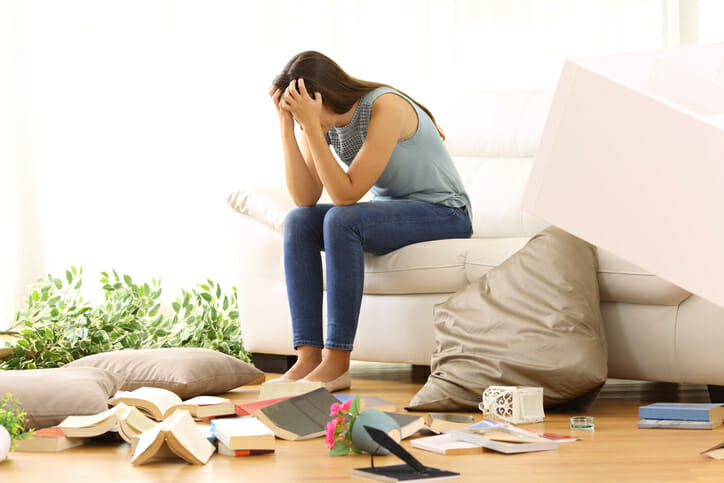 a fatigued woman looking at clutter